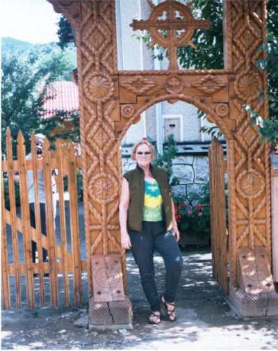 Kate in gate with elaborately carved ornamentation